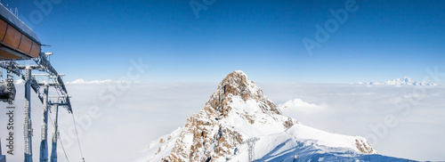 Mountain peak over the clouds in French Alps, Meribel
