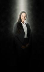 Office Girl Illuminated with Light Above on Black