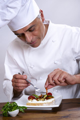 Chef elaborating a plate of food