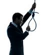 man holding adjusting hangman noose silhouette