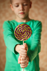 Two hand hold lollipop in the indoors