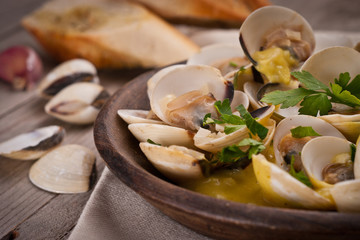 Fresh Cockle clams (Venus, Meretrix) with wine sauce. Portuguese