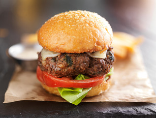 tasty gourmet burger with french fries and sauce