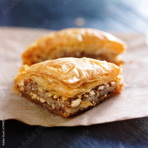 Fotobehang Dessert two pieces of baklava on wax paper