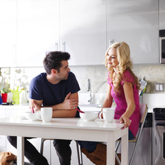 couple at home eating breakfast at table