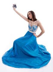 Beautiful woman in a blue dress shooting
