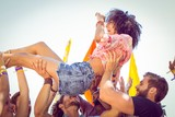 Fototapety Happy hipster woman crowd surfing