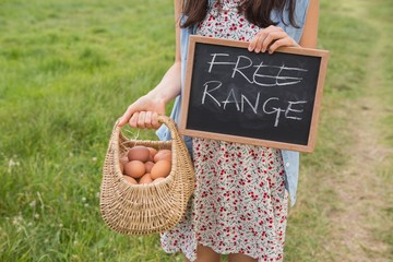 Woman holding basket of free range eggs