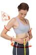 Composite image of portrait of a fit woman measuring waist