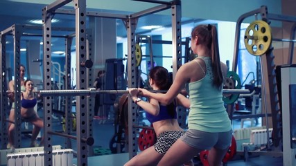 two girls hard squats