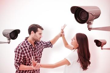 Fearful brunette being overpowered by boyfriend