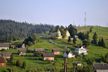 Landscape with hills on the panorama of the Carpathians village
