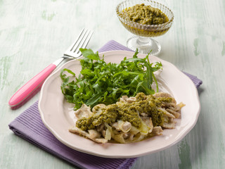 stewed meat with pesto sauce and arugula salad