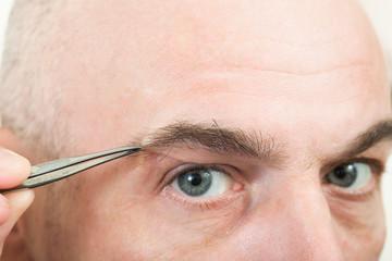 plucking eyebrows  man