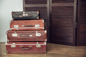 Old suitcases and dark wooden screen