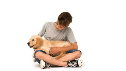 Happy boy with his puppy