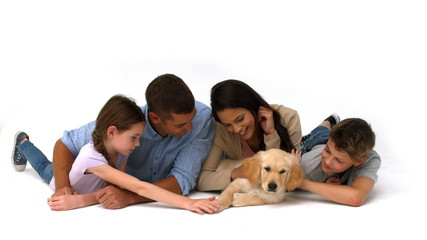 Happy family with their puppy on white background