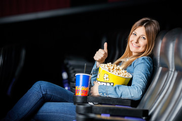 Happy Woman Showing Thumbsup At Cinema Theater