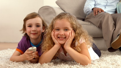Cute siblings looking at globe