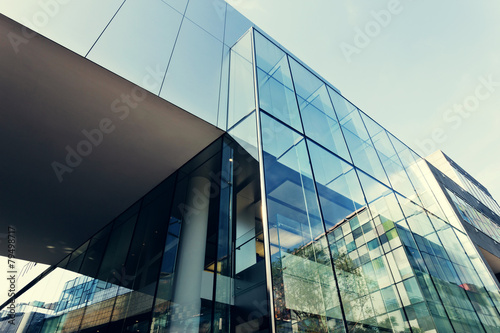 modern office building exterior and glass wall - 79498717