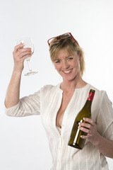 Female party goer holding glass of wine