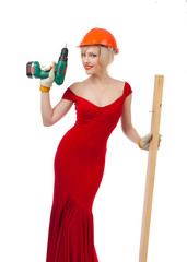 Beautiful blonde in a red dress with an electric drill