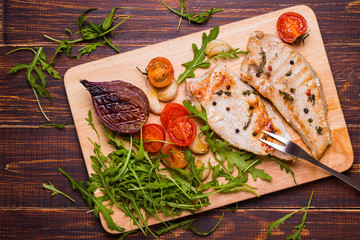 Grilled turkey steak on a cutting board