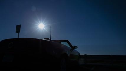 4K Time lapse pan shot convertible sun rising