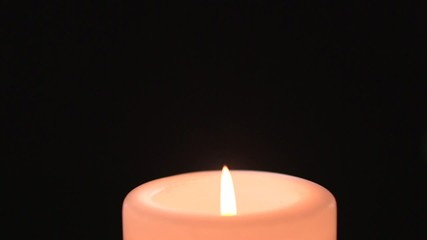 Pink candle burns and flames varies