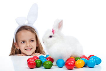 Happy little girl with her easter bunny