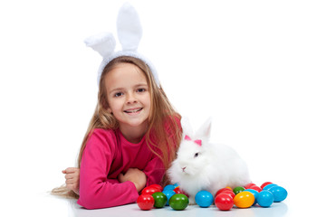 Happy girl with her easter rabbit