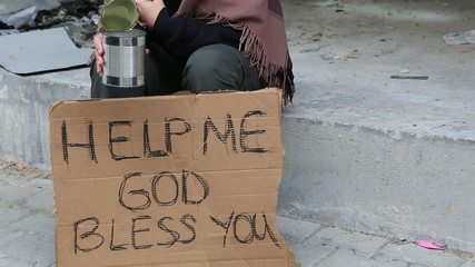 Homeless woman begging