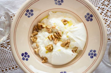 Italian Burrata Cheese Served With Olive Oil and Walnuts