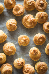 Freshly Baked Puffs on Baking Paper