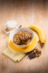 breakfast with chocolate cookie  muesli and banana