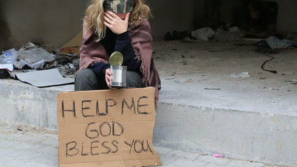 Homeless sick woman begging