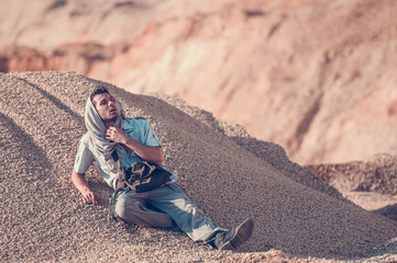 man exhausted in the desert