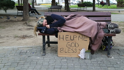 Tired homeless woman