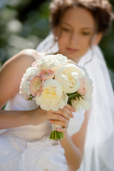 delicate bridal bouquet of roses and peons