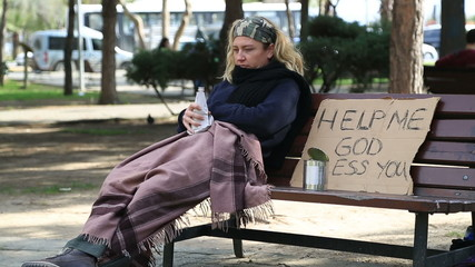 Homeless alcoholic woman drinking wine