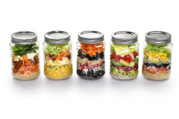 vegetable salad in glass jar, white background