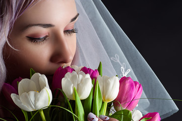 beautiful woman face with a bouquet of tulips