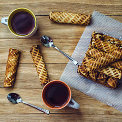 Homemade wafer rolls and cup of tea for couple