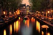 Canals of Amsterdam with bridge lit at night, Netherlands
