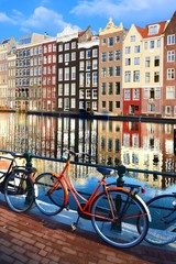 Bicycles along canals with reflections, Amsterdam, Netherlands
