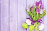 Purple tulip bouquet and easter eggs