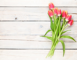 Colorful tulips on wooden table