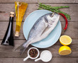 Постер, плакат: Fresh dorado fish cooking with spices and condiments