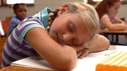 Schoolchild napping on notepad at school