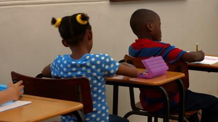 Cute schoolchildren in the classroom